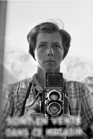 Vivian Maier, pictured here in a self-portrait, took thousands of photos but didn't show any of them in her lifetime.