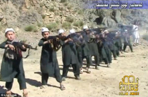 Trained to fight and die, children fire their AK-47s on command.