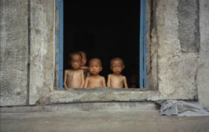 Starving children huddled in a window in North Korea. This is typical for those living in the countryside.