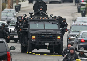 A Swat team sweeps the Watertown area in the hunt for suspect No. 2.