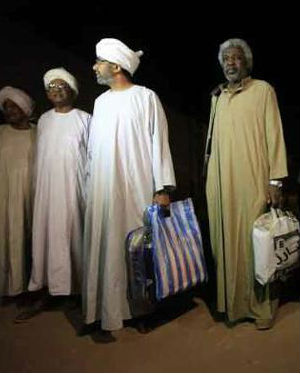 The six men walked free to the embrace of relatives waiting outside Kober Prison in the capital, Khartoum while the woman was released at a different location.