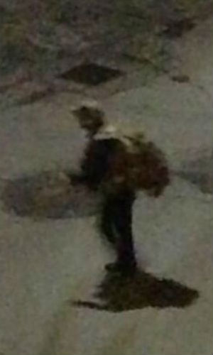 Is this their man? This photograph was tweeted by a resident near the shoot-out who claims it is one of the suspects fleeing on foot next to a scorch mark on the pavement.