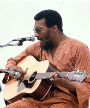 Richie Havens was originally slated to be the fifth act on the first day of Woodstock in August of 1969. Havens and two members of his band were pressed into service when the original opening acts were stuck in traffic.