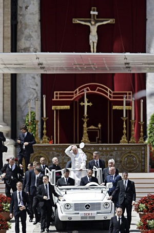 Pope Francis arrives for the Mass with the leaders of the ecclesial movements