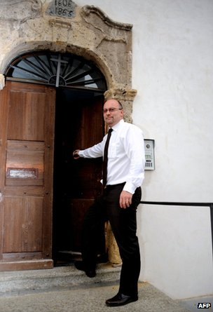 Father Pascal Vesin is seen outside his church in Megeve.