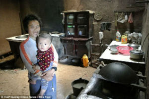 Du Xiurong with her grandchild, for whom she also says she will sell everything to ensure he has a good education.