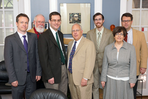 Pictured (left to right): Dr. Michael Boler, Dr. Edward Macierowski, Dr. Joseph Hattrup, Dr. R. Edward Houser, Dr. Andrew Hayes, Dr. Mary Catherine Sommers and Dr. Thomas Osborne in Sullivan Hall after Hattrup's defense.