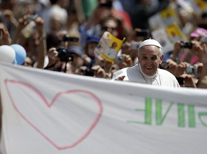 Pope travels through the crowd which filled St Peters square for the canonization