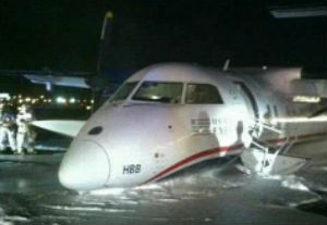 Emergency airport workers on the ground doused the plane in foam as a precaution.