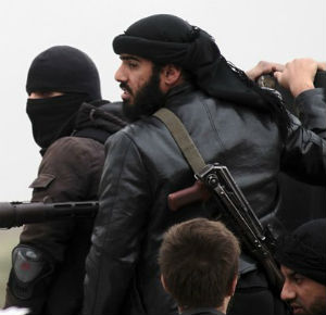 Fighters of the jihadist group Al-Nusra Front stand on the top of a pick-up mounted with a machine gun during fightings against the regime forces