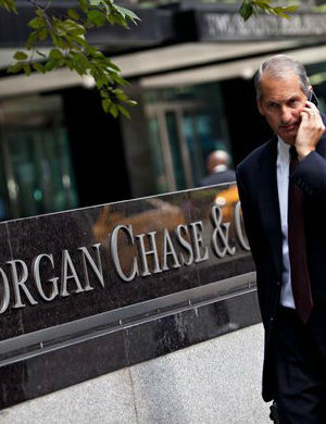 The payout is a settlement that traders in it Houston offices manipulated electricity markets in the states of California and Michigan. The decision will not directly penalize JPMorgan Chase executives.