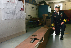 Princeton Deputy Fire Chief Roy James with the beam he hopes to erect as a memorial to those who died on 9-11.
