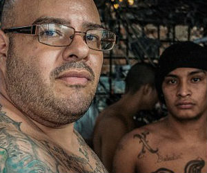 The prisoners sport their gang tattoos - which denote the membership of either the Mara Salvatrucha (MS-13) or Barrio 18 (M18) gangs.