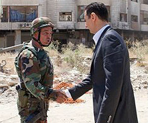 Syrian President Bashar al-Assad, right, expressed confidence of victory against the rebels in the ongoing civil war that has ravaged his nation over the past two years.
