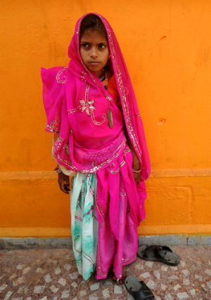 A child bride in India. Child marriages are common in poor and rural areas where wealthy men take advantage of poor families.