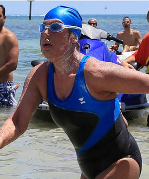 Sunburned and looking dazed, Diana Nyad walked on to the shore. As she approached the beach, spectators waded into waist-high water and surrounded her, taking pictures and cheering her on.