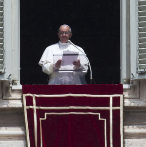 Pope addressing crowd in St. Peter's square during the Angelus.