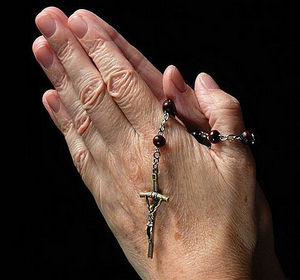 Hands in Prayer with Rosary.