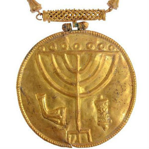 It's believed that the menorah medallion is most likely an ornament for a Torah scroll. If this is correct, it is the earliest Torah scroll ornament found in archaeological excavations to date