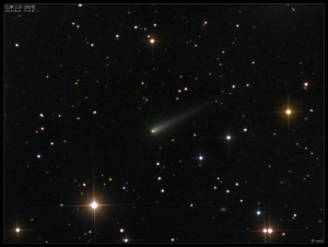 Comet ISON has a yellow-green tint in this image.