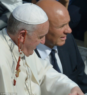Pope Francis caught a rosary with his ear yesterday.