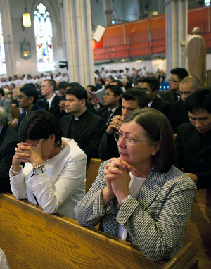 Catholics praying at Mass