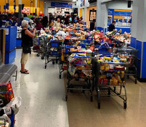A customer takes a photo of the aftermath, aisles of overstuffed carts left for employees to restock as credit limits and order were restored. Where's the shame?