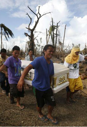 Areas devastated by Typhoon Haiyan across the Philippines are reportedly on the verge of anarchy. Troops and police struggle to control looting in streets, where rotting corpses remain uncollected.