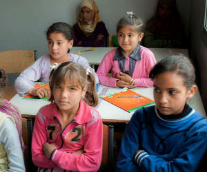 Most Syrian refugee children are being taught in refugee camps.
