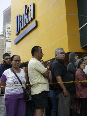 Venezuela's National Guard carrying assault rifles kept order at the stores as savvy shoppers rushed to get inside.