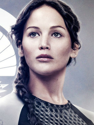 The story of a brave female archery champion struggling to set things aright in a dystopian society evidently still entrances the world - or at least those who buy movie tickets.