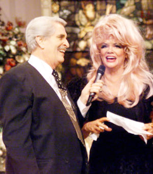 The nightly talk show 'Praise the Lord,' hosted by the silver-haired Paul Crouch and his flamboyantly coiffed wife Jan was broadcast from an Orange County studio decorated with stained-glass windows, gilded imitation antiques and plush pews for the audience.