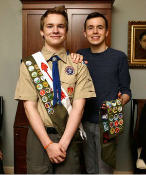 Pascal Tessier, 16, center left, a Boy Scout, and his brother Lucien Tessier, 20, pose for a portrait with their parents at their home in Kensington, Maryland, earlier this year.