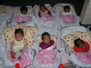 Babies in an orphanage in India. It's a better alternative to murder, but still not the best.