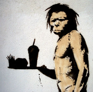 This street art from Banksy theorizes on how Neanderthals became extinct.