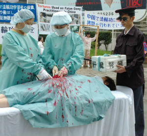 Falun Gong practitioners, in protest of the practice of organ harvesting among religious and ethnic minorities reenact the practice in a grisly bit of street theater.