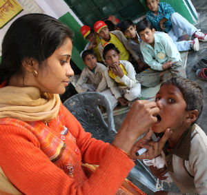 In order to stop the growth of polio in India, millions of health workers, community mobilizers, and vaccinators were involved in the drive to immunize children with polio drops.
