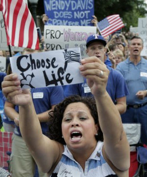 Supporters of an abortion bill cheer during an anti-abortion rally at the Texas Capitol, Monday, July 8, 2013, in Austin, Texas.