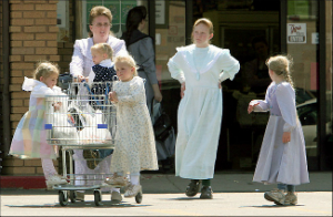 Polygamy isn't all sister wives and fun. A woman in Hilldale, Utah, where polygamy is ubiquitous, exits a store with several children.