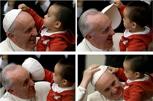 Pope Francis and a child
