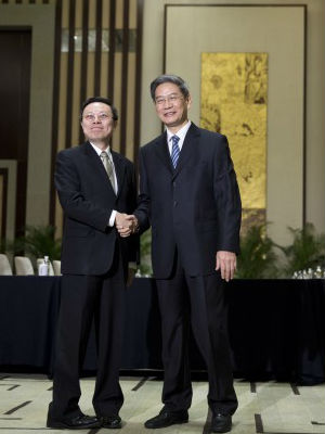 China and Taiwan hailed a new chapter in their relations on Tuesday and said their ties would advance after they held their highest-level government talks since they split amid civil war in 1949.