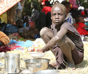 The South Sudanese girl eats her meager ration. Many of South Sudan's 3.7 million people are entirely reliant on external aid for survival.