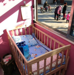 Children who are left in Tianjin are dropped off in a cozy room with pink walls, a cradle and an incubator.