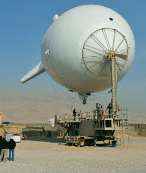 A persistent surveillance system (PSS) launches from Forward Operating Base Khilegay, Afghanistan, Dec. 30, 2010. The PSS consists of an aerostat, also called a blimp, and mounted camera equipment capable of high-resolution imagery and high-quality video that provides instant situational awareness throughout the region.