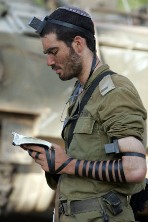 Known in Judaism by the Hebrew term tefillin, Phylacteries are pairs of leather cases containing biblical passages from the books of Exodus and Deuteronomy. In tradition, one case is bound by leather thongs to the head and one to the arm during morning prayers.
