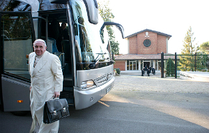 Pope Francis arrives by bus for a spiritual retreat at a retreat house near Rome.