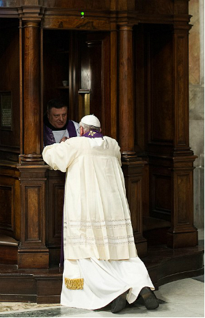 Pope Francis kneels before an ordinary priest to make his confession.