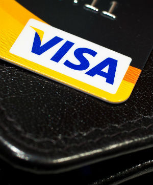 Wal-Mart objects to the requirement that retailers who want to accept any payments via Visa honor all issuers' Visa-branded cards.