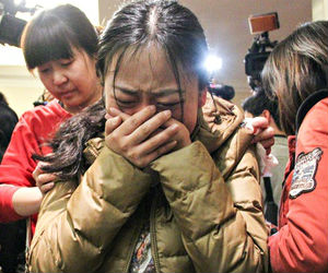 The anxious, bereaved relatives of the Chinese passengers on board MH370 watched announcements from Australia on monitors set up at the Beijing hotel.