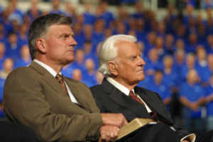Franklin Graham (left) and his father, Billy Graham (right).